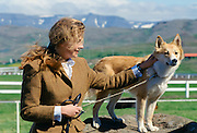 Woman with traditional Icelandic dog at Dalur, Iceland