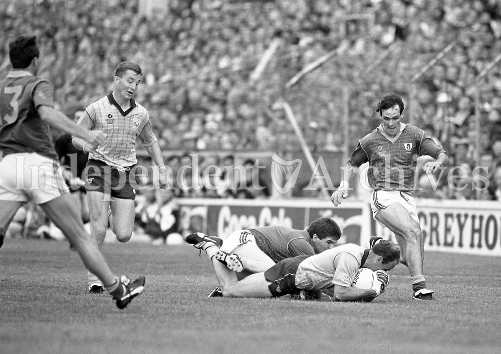790-630<br /> Leinster Football Final at Croke Park, Dublin v Meath, 29th July 1990:<br /> Action on the pitch.<br /> Meath 1-14 Dublin 0-14<br /> Pic: Dara Mac Donaill, 29/7/90<br /> (Part of the Independent Newspapers Ireland/NLI Collection)