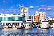 Marina Jack restaurant and yachts with city skyline, Sarasota, Florida, USA.