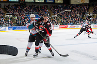 KELOWNA, CANADA - MARCH 1: Nick Merkley #10 of the Kelowna Rockets checks Jesse Gabrielle #13 of the Prince George Cougars on MARCH 1, 2017 at Prospera Place in Kelowna, British Columbia, Canada.  (Photo by Marissa Baecker/Shoot the Breeze)  *** Local Caption ***