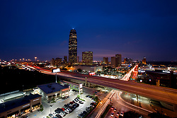 Stock photo of the Galleria and Williams tower at night with passing freeway traffic