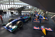"Hangar-7; the spectacular home of the Flying Bulls (""Red Bull"" owner Didi Mateschitz' collection of classic airplanes) next to Salzburg W.A. Mozart airport. Red Bull Sauber Petronas Formula One and Indy racing cars, North American B-25J Mitchell twin-engine aircraft."