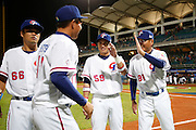 NEW TAIPEI CITY, TAIWAN - NOVEMBER 15:  Chang-Heng Hsieh #81 manager of Team Chinese Taipei greets members of Team Chinese Taipei during player introductions before Game 2 of the 2013 World Baseball Classic Qualifier against Team New Zealand at Xinzhuang Stadium in New Taipei City, Taiwan on Thursday, November 15, 2012. Photo by Yuki Taguchi/WBCI/MLB Photos