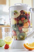 Blender filled with fresh fruits close-up