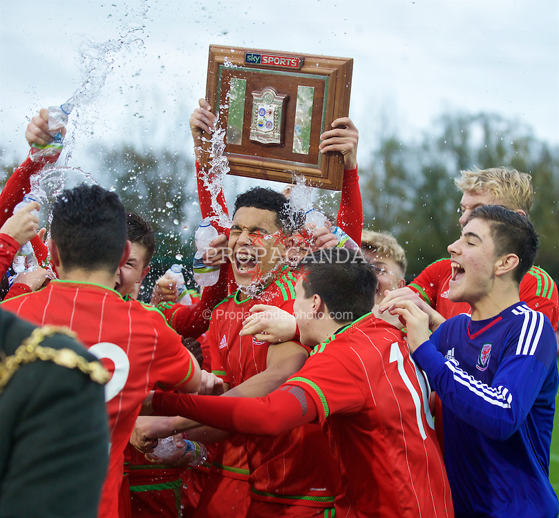 NEWPORT, WALES - Thursday, November 5, 2015: Wales' Benjamin Cabango leads the celebrations after a 3-1 victory over Northern Ireland sealed the Victory Shield during the Under-16's Victory Shield International match at Dragon Park. (Pic by David Rawcliffe/Propaganda)