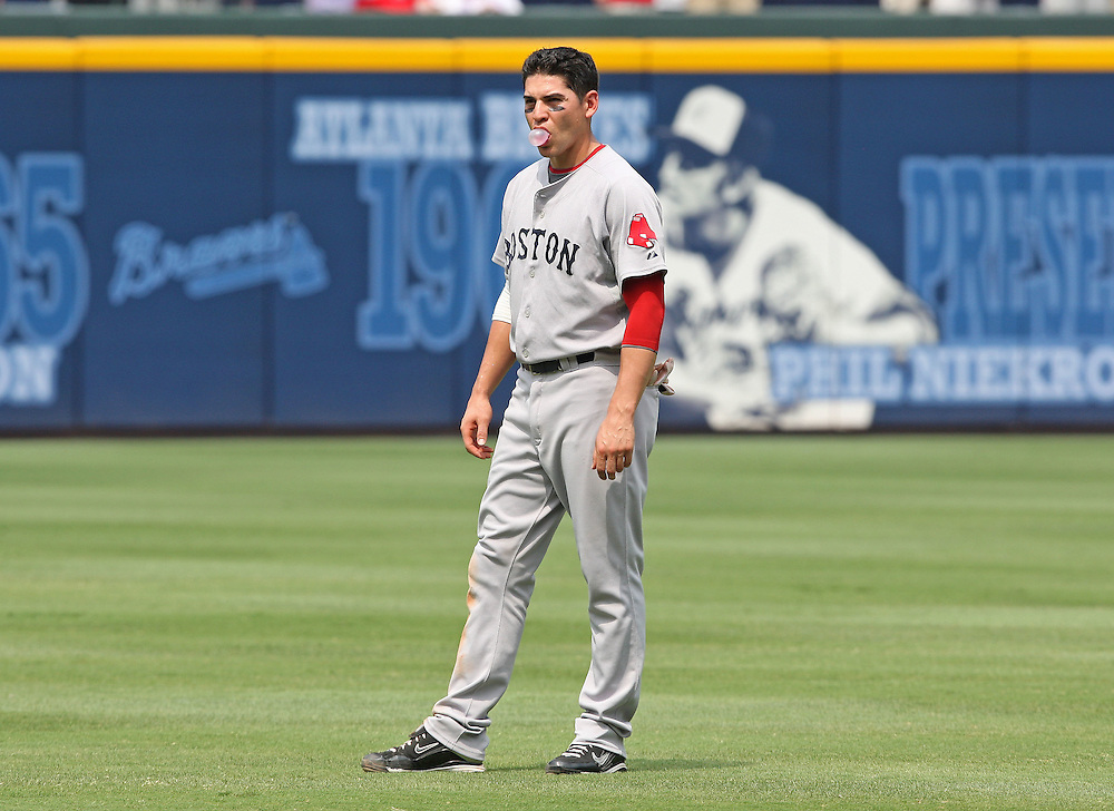 ATLANTA - JUNE 28:  Center fielder Jacoby Ellsbury #46 of the Boston Red Sox waits for his hat and glove after making the last out of an inning during the game against the Atlanta Braves at Turner Field on June 28, 2009 in Atlanta, Georgia.  The Braves beat the Red Sox 2-1.  (Photo by Mike Zarrilli/Getty Images)
