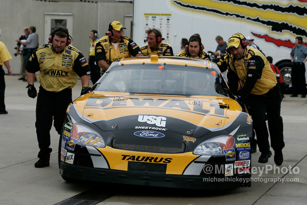 Matt Kenseth's crew pushes his car back to his garage during practice for the Allstate 400 at the Brickyard.