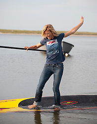 woman slipping off a paddleboard in Amagansett, NY