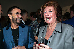 "**FILE PICTURE - Singer and presenter Cilla black has died at the age of 72** 19/05/2011. Beatle Ringo Starr and Cilla Black sharing a joke. Opening of the Tommy Nutter Exhibition ""Rebel on the Row"" at the Fashion and Textile Museum, London. Photo credit should read BETTINA STRENSKE/LNP"