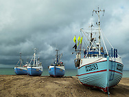 Fishing boats on the beach at Throup Strand Jutland outside of Copenhagen