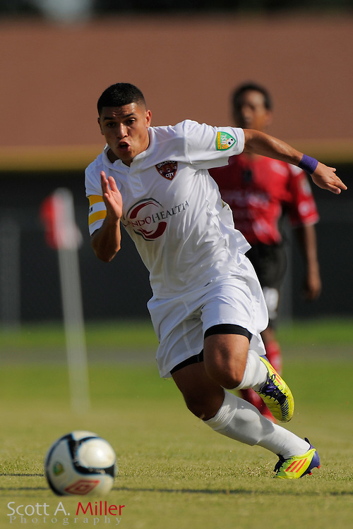 Orlando City midfielder Jonathan Mendoza (11) in action during Orlando City's 2-1 win over Laredo Heat in their PDL Southern Conference Championships playoff game at Trinity Catholic High Schooll on July 20, 2012 in Ocala, Florida. ..©2012 Scott A. Miller