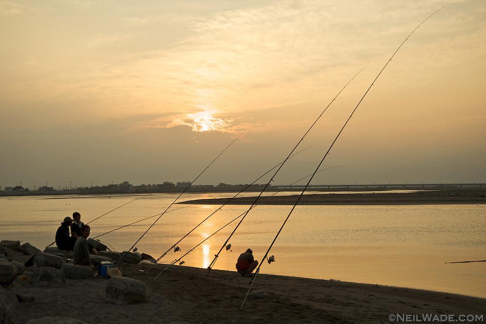 Fishing on a beach near Yilan, Taiwan.