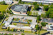 Nederland, Noord-Brabant, Vught, 13-05-2019; PI Vught - Penitiaire Inrichting Vught, overzicht, het complex huisvest onder andere de gevangenis, Huis van Bewaring (HvB) en Extra beveiligde inrichting (EBI), het half ronde gebouw. Verder op het terrein Inrichting voor Stelselmatige Daders (ISD), , Terroristen Afdeling (TA), Beheersproblematische Gedetineerden (BPG), Langdurige Forensische Psychiatrische Zorg (LFPZ), Zeer intensieve Specialistische Zorg (ZISZ) als een Penitentiair Psychiatrisch Centrum (PPC).<br /> Prison complex Vught.