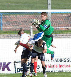 Falkirk's keeper Michael McGovern over Falkirk's Will Vaulks.<br /> Cowdenbeath 1 v 0 Falkirk, 14/9/2013.<br /> &copy;Michael Schofield.
