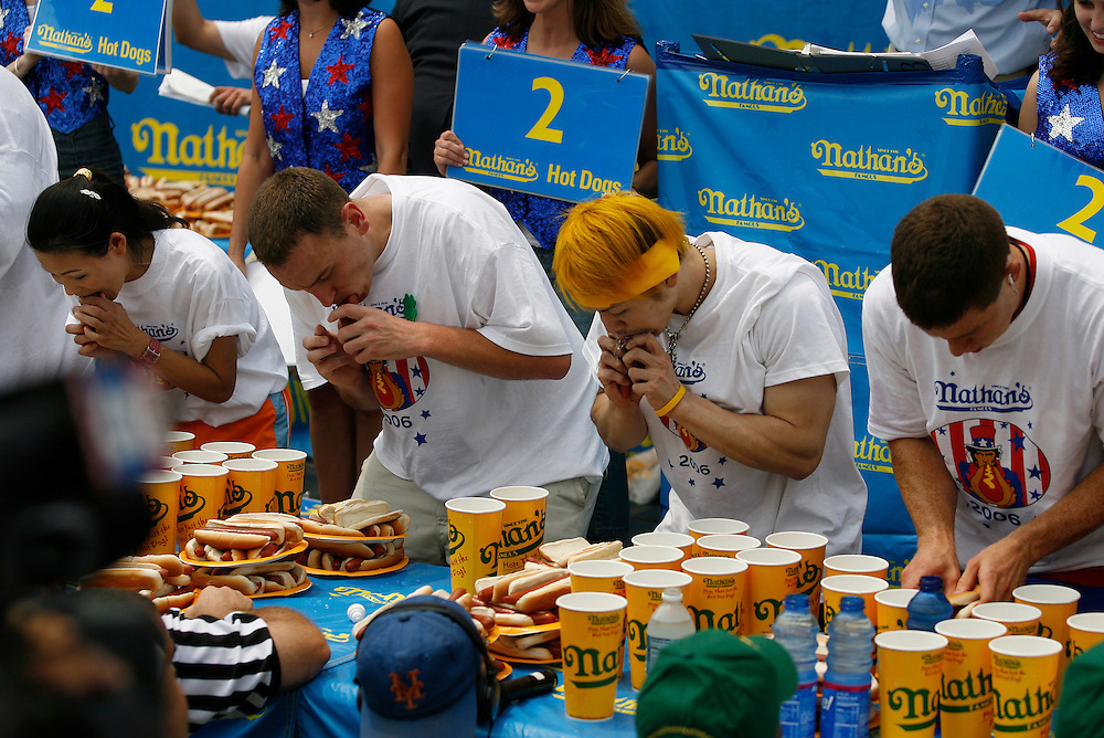 NEW YORK, NY-06 JUL04-- Sonya Thomas, American favourite Joey Chestnut, Titleholder Takeru Kobayashi and rookie Eric the Red get started. (Extra) Liam Maloney/The Gazette