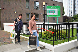© Licensed to London News Pictures. 24/06/2017. London, UK. Residents continue to be evacuated from the Burnham block on the Chalcots Estate in Camden after it failed a fire inspection because of combustable cladding. More than 700 flats in tower blocks on an estate in the Swiss Cottage area of north-west London are being evacuated because of fire safety concerns. Photo credit: Ben Cawthra/LNP