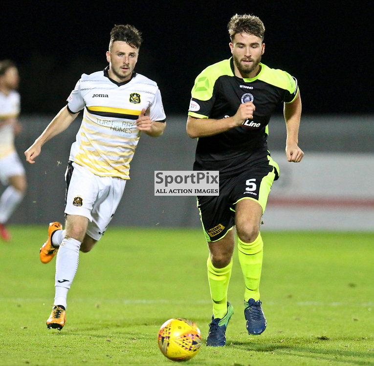 Calum Gallagher chases down Morgyn Neill during the Dumbarton v Stranraer Irn Bru Cup round three 06 October 2017<br /> <br /> <br /> <br /> <br /> <br /> (c) Andy Scott | SportPix.org.uk