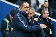 Chelsea Manager Mourizio Sarri shares a smile with Brighton and Hove Albion manager Chris Hughton during the Premier League match between Brighton and Hove Albion and Chelsea at the American Express Community Stadium, Brighton and Hove, England on 16 December 2018.