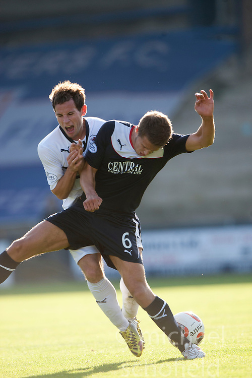 Raith Rovers Kevin Moon and Falkirk's Will Vaulks. <br /> Raith Rovers 1 v 1 Falkirk, Scottish Championship 28/9/2013.<br /> &copy;Michael Schofield.