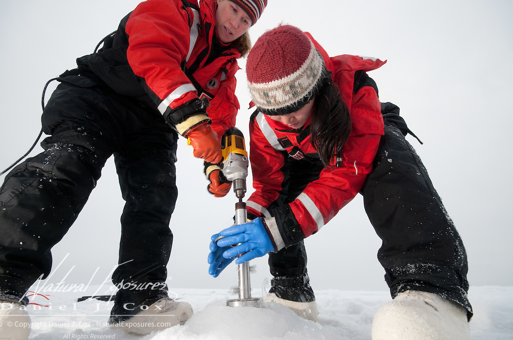 Metta Kaufman and Brenna McConnell from the University of Alaska, Fairbanks, taking ice core samples from the ice of the Arctic Ocean.