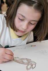 Christies, St James, London, March 4th 2016. Nine year-old Ashley Hubbard creates an artwork at the preview for the It&rsquo;s Our World charity auction at Christie's. Over 40 leading artists including David Hockney, Sir Antony Gormley, David Nash, Sir Peter Blake, Yinka Shonibare, Sir Quentin Blake, Emily Young and Maggi Hambling have committed artworks to the It&rsquo;s Our World Auction in support of The Big Draw and Jupiter Artland Foundation, to be sold at Christie&rsquo;s London on 10 March 2016.<br />  ///FOR LICENCING CONTACT: paul@pauldaveycreative.co.uk TEL:+44 (0) 7966 016 296 or +44 (0) 20 8969 6875. &copy;2015 Paul R Davey. All rights reserved.