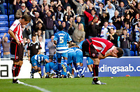 Photo: Leigh Quinnell.<br /> Reading v Sheffield United. Coca Cola Championship.<br /> 01/10/2005. Reading players celebrate Brynjar Gunnarssons goal as Sheffield United hang their heads in shame.