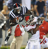 Mississippi's Rodney Scott (2) hurdles Fresno State's Desia Dunn during an NCAA college football at Vaught-Hemingway Stadium in Oxford, Miss. on Saturday, Sept. 25, 2010. (AP Photo/Oxford Eagle, Bruce Newman) ** MAGS OUT NO SALES MANDATORY CREDIT **