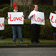 From left, Dino Macioci, Joey Adams, Owen Anderson and Stacy Chan, all of Tacoma, hold signs outside the Life Center church on Saturday, February 11, 2012 in Tacoma after the funeral for Braden and Charlie Powell. The boys were killed by their father Josh Powell during a supervised visit near Graham, Wash. (Photo by Joshua Trujillo, seattlepi.com)