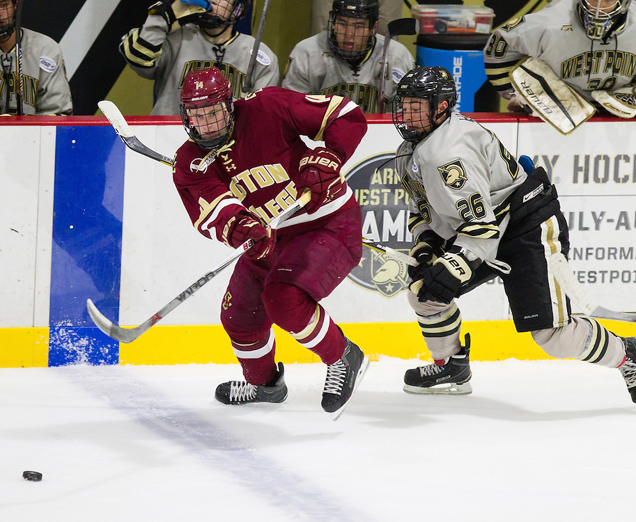Boston College Forward Adam Gilmour (14) passes the puck during the second period of a NCAA hockey game between Army and Boston College at Tate Rink on October 9, 2015 in West Point, New York. (Dustin Satloff)