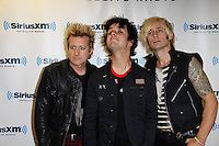 Green Day visits the studios of SiriusXM on September 14, 2012 .L to R ; Tre Cool, Billie Joe Armstrong and Mike Dirnt.