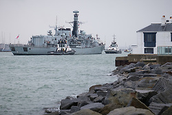© Licensed to London News Pictures. 04/11/2016. Portsmouth, UK.  Type 23 Frigate, HMS Iron Duke returning to Portsmouth Naval Base today, on the day that the defence secretary, Michael Fallon, announced that the Type 26 shipbuilding programme of eight ships will start in summer 2017 at BAE Systems on the Clyde.  The new 'Global Combat Ship' will be a replacement to the Type 23 Duke Class Frigate, such as HMS Iron Duke. Photo credit: Rob Arnold/LNP