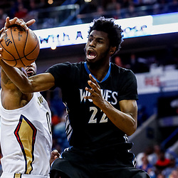 Mar 19, 2017; New Orleans, LA, USA; New Orleans Pelicans forward DeMarcus Cousins (0) blocks a shot by Minnesota Timberwolves forward Andrew Wiggins (22) during the first quarter of a game at the Smoothie King Center. Mandatory Credit: Derick E. Hingle-USA TODAY Sports