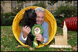 Conservative Party MP Alan Duncan and Minister of State for International Development wins Westminster Dog of the Year 2013 with his dog Noodle. London, United Kingdom. Thursday, 10th October 2013. Picture by Andrew Parsons / i-Images