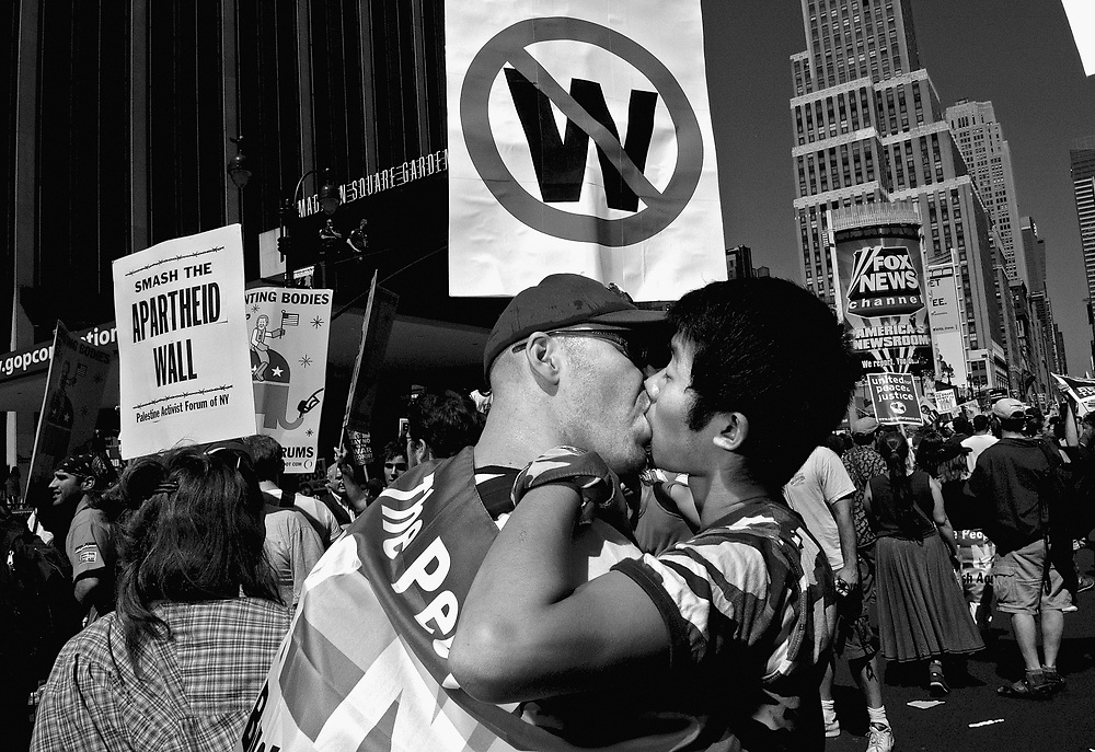 NEW YORK - More than 400, 000 demonstrators marched past a heavily fortified Republican convention hall on Sunday, chanting denunciations of the administration and the war in Iraq as delegates flocked to the city to nominate President Bush for four more years in the White House. <br /><br />Bush and Kerry are locked in a tight race for the White House, although recent polls suggest momentum for the president. A group of Vietnam veterans have been running commercials accusing Kerry of lying about his decorated service in Vietnam, allegations that official Navy documents dispute and Kerry has denounced as a Republican-driven smear. Still, fellow Democrats concede the unsubstantiated claims may be hurting his candidacy.<br /><br /> Polls show the war in Iraq has become increasingly unpopular in recent months, and the throng of protesters filling 20 city blocks on a steamy Manhattan afternoon underscored that. &quot;No More Bush,&quot; and &quot;No More Years,&quot; were two of the more popular chants. &quot;Bush Lies, Who Dies?,&quot; read some of the signs.<br /><br /> Several protesters carried flag-draped, coffin-shaped boxes through the streets, meant to draw attention to the U.S. death toll in Iraq.<br /><br /> Police gave no official crowd estimate of the day's protest. One official put the size at 120,000, although it took nearly five hours for the procession to pass Madison Square Garden. Delegates meet there beginning Monday to nominate Bush and Cheney for second terms.<br /><br /> Organizers claimed they had turned out roughly 400,000 protesters.<br /><br /> In all, about 100 arrests were reported, with no major outbursts of violence. At mid-afternoon, a small fire erupted along the protest route a half block from the Garden. Police quickly doused the flames, then handcuffed two people and led them away.<br /><br /> Thousands of police, some dressed in riot gear, others bearing automatic weapons, watched as the protesters passed. Extensive as it was, the forc