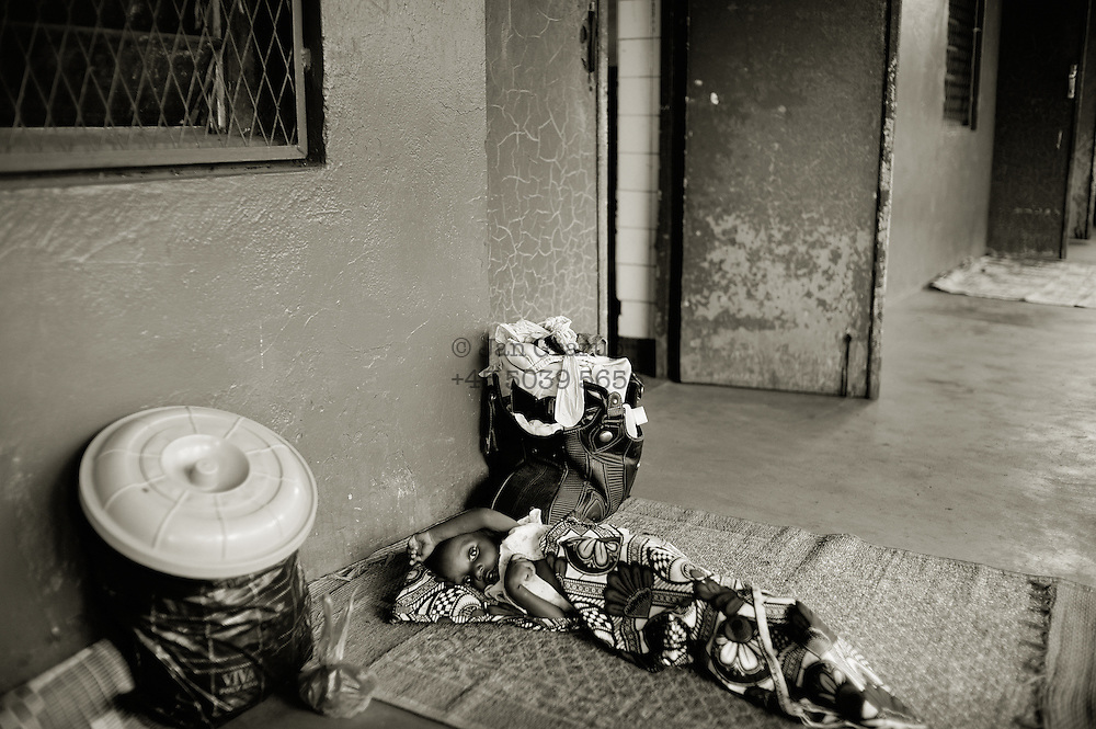 A malnutritioned boy lying outside the ward due to a full hospital. many families goes to the hospital without getting access to the wards because of the high numbers of sick children.The central African rep. has some of the world's worst child welfare indicators. The infant mortality rate is 112, and out of 1,000 children born in CAR, 171 will die before reaching the age of five. The five main child killers in CAR are malaria, diarrhoea, acute respiratory infections, malnutrition and measles – all preventable diseases. The Accelerated Child Survival and Development Strategy UNICEF is implementing aims to reach every newborn and child in every district with a set of priority interventions. Evidence shows that there are a number of known and affordable interventions that if implemented fully could prevent 63 per cent of current childhood mortality.