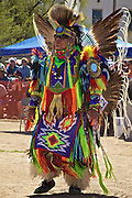 Native American Fancy Dancer get ready for Pow Wow dance competition.