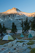 The first rays of sunlight greet a backcountry campsite at Glacier Lake, Eagle Cap Wilderness, Oregon