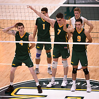 3rd year middle blocker Cody Caldwell (4) of the Regina Cougars in action during Men's Volleyball home game on November 3 at Centre for Kinesiology, Health and Sport. Credit: Casey Marshall/Arthur Images