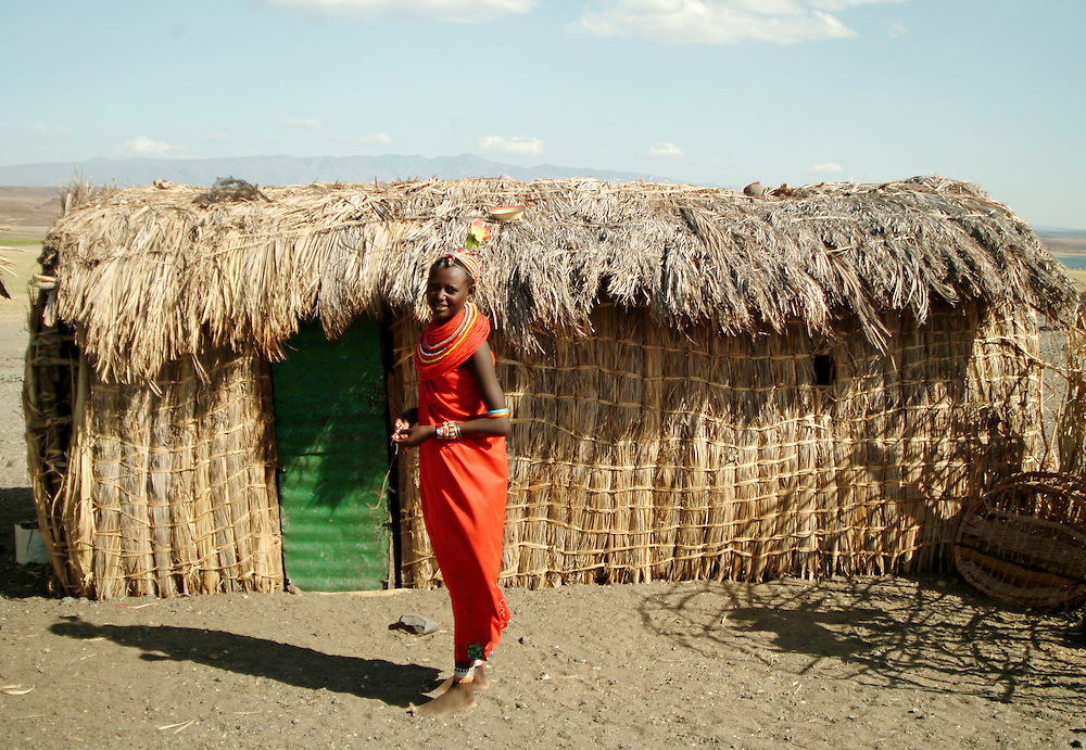 Africa. Northern Kenya. Lake Turkana. .El Molo village. Girl infront of her home..CD0012