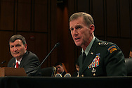 Ambassador Karl W. Eikenberry, US Ambassador  to Afghanistan and General Stanley A. McChrystal commander, International Security Assistance Forces and commander U.S. Forces in Afghanistan at a hearing of the Senate Armed Services Committee on December 8, 2009.  Photograph by Dennis Brack