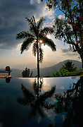 Sunset over the Blue Mountains  reflected in the pool - view from Strawberry Hill Jamaica