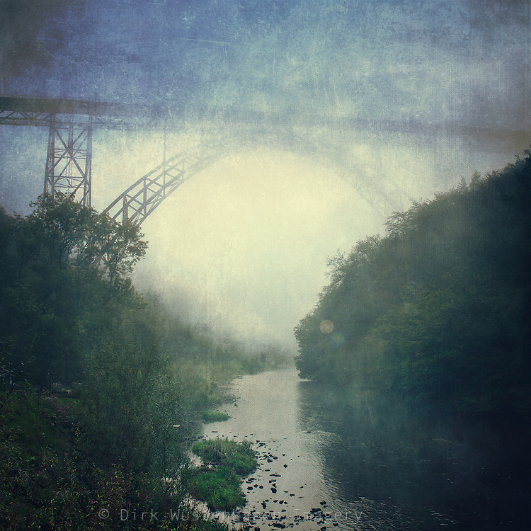 View over M&uuml;ngstener Br&uuml;cke, Germany and river Wupper on a misty morning. <br /> Prints &amp; more: http://society6.com/DirkWuestenhagenImagery/Bridge-River-Fog_Print