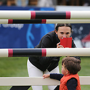 NORTH SALEM, NEW YORK - May 15: Georgina Bloomberg takes pictures of her son Jasper while walking the course before competition during The $50,000 Old Salem Farm Grand Prix presented by The Kincade Group at the Old Salem Farm Spring Horse Show on May 15, 2016 in North Salem. (Photo by Tim Clayton/Corbis via Getty Images)
