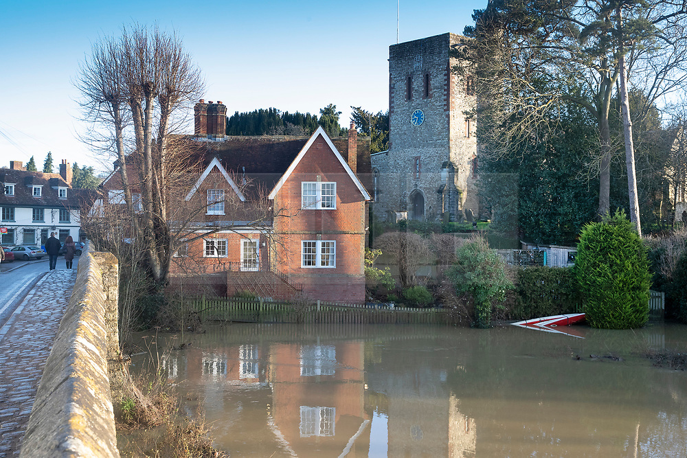 © Licensed to London News Pictures. 23/12/2019. Yalding, UK. The River Beult remains in flood in Yalding, Kent.  River levels are beginning to drop in some areas after days of heavy rain in the south. Photo credit: Peter Macdiarmid/LNP