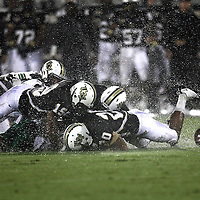 UCF players scramble for the ball after Marshall quarterback Rakeem Cato (12) fumbles the football during an NCAA football game between the Marshall Thundering Herd and the Central Florida Knights at Bright House Networks Stadium on Saturday, October 8, 2011 in Orlando, Florida. (Photo/Alex Menendez)