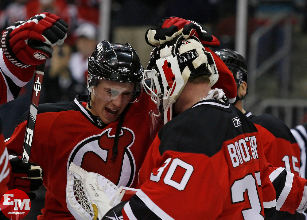 Feb 26, 2009; Newark, NJ, USA; New Jersey Devils left wing Zach Parise (9) congratulates New Jersey Devils goalie Martin Brodeur (30) at the Prudential Center. The Devils defeated the Avalanche 4-0.