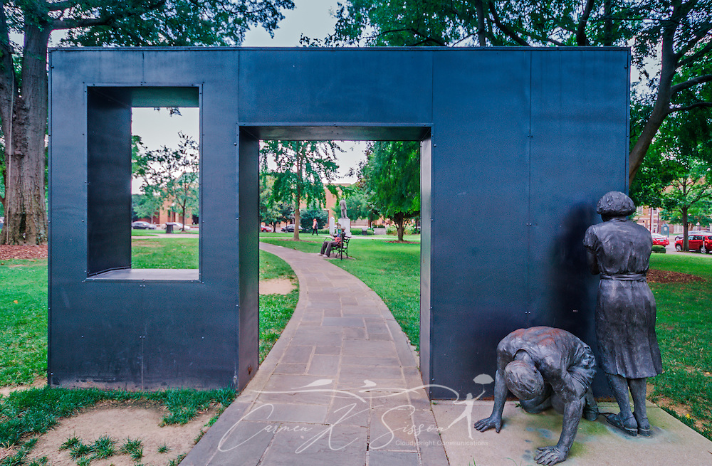 Two teenagers are immortalized in bronze as they hide from water cannons, July 12, 2015, at Kelly Ingram Park in Birmingham, Alabama. The four-acre park is located in the Birmingham Civil Rights District and was one of the main staging area for civil rights activists. Numerous activists were attacked on the site by high-power water hoses and police dogs, with key moments immortalized in bronze throughout the park. (Photo by Carmen K. Sisson/Cloudybright)