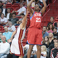 14 March 2010: Philadelphia 76ers guard Lou Williams takes a jumpshot over Carlos Arroyo during the Miami Heat 100-89 victory over the Philadelphia 76ers at the AmericanAirlines  Arena, in Miami, Florida, USA.