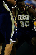 25 November 2005: Oral Roberts University junior forward, Caleb Green (30) laughs after being helped up after taking a fall in ORU's loss to Marquette University 70-73 at the Great Alaska Shootout in Anchorage, Alaska