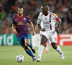 13-09-2011 VOETBAL: CHAMPIONS LEAGUE FC BARCELONA - AC MILAN: BARCELONA<br /> Javier Mascherano and Clarence Seedorf <br /> *** NETHERLANDS ONLY ***<br /> ©2011-FRH-nph /Alterphoto/ Cesar Cebolla